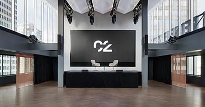 Espace C2 montreal big room with lighting and a big screen and two chairs grande salle avec éclairage et un grand écran et deux sièges